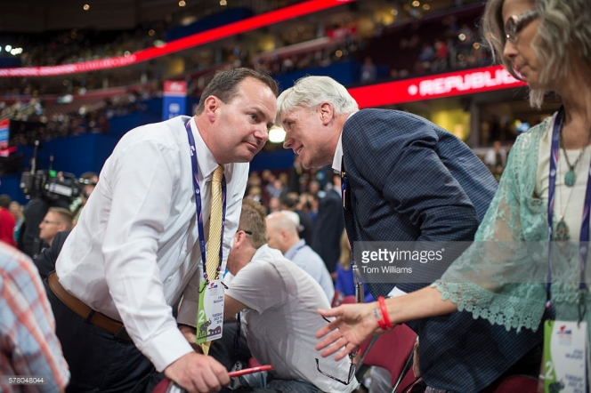 UNITED STATES - JULY 19: Sen. Mike Lee, R-Utah, left, talks with Phill Wright, chairman of the Utah delegation, on the floor of the Quicken Loans Arena at the Republican National Convention in Cleveland, Ohio, July 19, 2016. (Photo By Tom Williams/CQ Roll Call)
